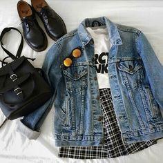 | White Arctic Monkeys Tee | Plaid Black and White Checkered Skirt | Light Washed Denim Jacket | Black Doc Martens | Black Bag | Circular Sunglasses |