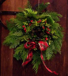 St Giles, Ludford, Christmas 2012 - wreath on church door.  Created by young novice Vita Unwin.
