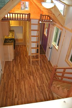 322 sq. ft. tiny house. I like the flooring and the railing around the bedroom loft.