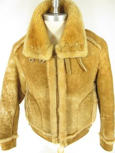 This is an interesting type of B-3 bomber jacket with its light tan color. THis screams unique style.