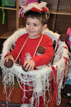 "Spaghetti and Meatballs Costume: yarn ""noodles"" and brown Styrofoam for ""meatballs"".  :]"