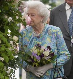 Queen Elizabeth II at the Chelsea Flower Show... My Queen taking the time to smell the roses.