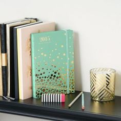 A beautiful Mint Confetti 2015 Planner with lay-flat binding. fa37c597a