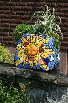 oh my gosh!  planter made with mosaic on toilet tank!  What fun.