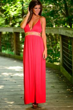 This maxi is stunning! The gorgeous coral color with the gold waistband is amazing! It adds that touch of sparkle that you need! So elegant!