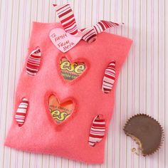 Felt Candy Pouch with Cutouts - Give a sneak preview of what's inside this candy sack with two heart shapes cut from the felt. Hold the felt pouch together with a wide ribbon threaded through two holes punched on either side, and keep it secure by tying the ribbon at the top. Add a heart-shape gift tag with the recipient's name to finish the gift.