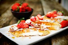 To finish the dish off, dust each slice with confectioner's sugar and slivered almonds. Left over strawberries and cream can also be spooned on top of each slice. Serve with maple syrup if desired.