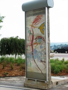 See a piece of the Berlin Wall right here in Cincinnati.  This piece sits just south of the National Underground Railroad Freedom Center downtown. Click the pic to learn more over at our blog.
