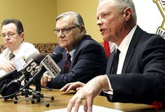 In this Dec. 5, 2011 file photo, Maricopa County Sheriff Joe Arpaio, center, listens as Chief Deputy Jerry Sheridan, right, discusses the latest in the document release on his office's handling of many sexual assault cases over the years in El Mirage, Ariz., during a news conference in Phoenix. Arpaio and his top aide Sheridan are required to appear before a federal judge who believes the two have mischaracterized and trivialized the judge's key findings in a racial-profiling decision…