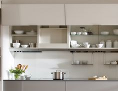 SANTOS kitchen. Comfort and beauty. The wall units for pull-out hoods, apart from offering extra storage space, allow the hood to be fully integrated in the wall area once it is closed.  They help maintain the uniformity of the kitchen whilst making cleaning easier. It is easier to clean a cabinet than to clean a stainless steel decorative extractor hood. Extra Storage Space, Storage Spaces, Kitchen Organization, Kitchen Storage, Aesthetic Solutions, Extractor Hood, Home Kitchens, Modern Kitchens, Interior Design Kitchen