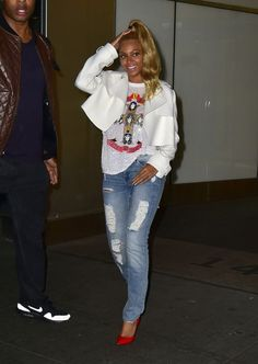 Beyonce in a sparkly shirt and jeans in New York City.