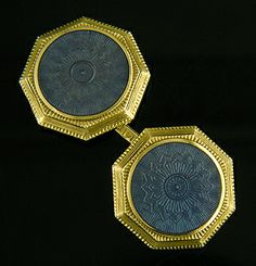 A regal pairing of blue and yellow.  The cufflinks feature translucent blue enamels.  Beneath the enamels is a beautifully engraved radiating star or sun.  A wonderful example of guilloche enameling.  The elegant blue centers are surrounded by yellow gold borders with dramatic mille grain edges.  Crafted in 14kt gold,  circa 1925.