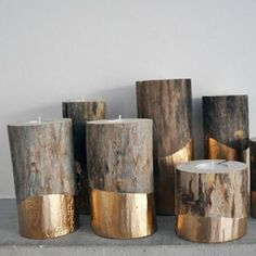 DIY Gold-dipped painted log candles.