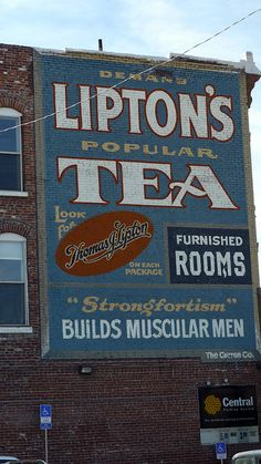 'Demand Popular Lipton's Tea' giant advertising ghost sign [fading handpainted ad sign] painted on wall of brick building, prob dates from first half of 20th century, could be restoration or reproduction