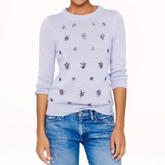 J. Crew Jeweled Cluster Sweater J. Crew Jeweled-Cluster Sweater in lavender. Spun from soft Italian yarns with hand-applied jewels, this sweater is ready for a holiday party or two. In excellent condition!!  Polyacrylic/wool/mohair in a 7-gauge knit. Three-quarter sleeves. Rib trim at neck, cuffs and hem. Hand wash. Semifitted. Hits at hip.  NO Trades. Please make all offers through offer button. J. Crew Sweaters