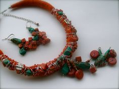 The hand beaded necklace is made with turquoise stone, red sponge coral beads, sun stone beads and silvered wire. The hand beaded earrings are made with