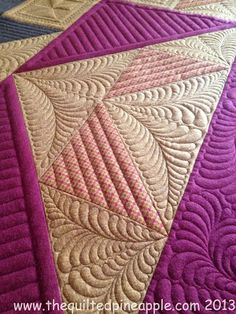 THE QUILTED PINEAPPLE: Fireside Star Quilt I like the combination of straight lines and feathers