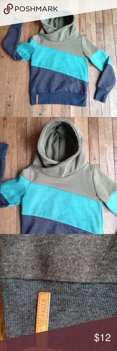 """Sage green, teal, & gray colorblock Hua Lan hoodie VGUC. Some wash wear and slight pilling. Large hood with asymmetrical neckline. Heathered sage green, teal, and gray blocks of color. There is no tag that lists materials, however this feels like a cotton blend. (The inside is so soft and comfy!). This is a large, yet feels more like a medium. There is no string for the hood. """"Desert Eagle"""" style. I wish this fit me! It is so cute and comfortable. I love the colors! 😍 Hua Lan Tops…"""