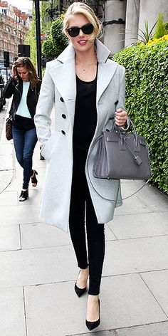 Love Her Outfit! Star Style to Steal | KATE UPTON | The supermodel seems to have picked up a tip or two from her many photoshoots: Her all-black look with pops of gray (thanks to the ash Vivienne Westwood Anglomania wool trench and blue-gray structured tote) is simple, slimming and chic as all get-out.