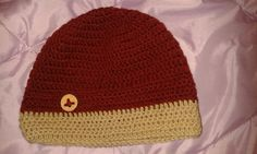 Crocheted unisex hat with a piece of wine cup as button