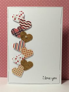 Inspired by a lovely card I saw on Pinterest. Punched hearts card | docrafts.com