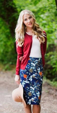 Rust Floral Pencil Skirt    A modest, stylish, navy skirt with a rust colored floral print. Pencil skirt cut. Paired with the Round Neck Lace Top in white and the Scarlet Red Cardigan.  Modest skirts