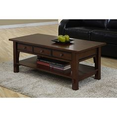 Style meets functionality with this sophisticated coffee table with drawers. Ideal for displaying treasured keepsakes, the tables three drawers offer discreet storage of your items. The beautiful walnut cherry finish will complement any decor.