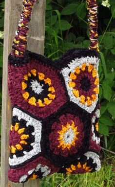 All girls love bags, and those are super cute!  This burgundy shoulder bag is one of a kind. Because of the scarcity of the yarn this colorful shoulder bag won't be available to buy again once it has been sold.