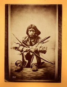 Young Shoshone Indian warrior with a bow and arrow, circa 1860s