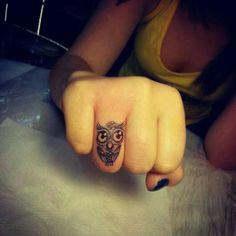 Owl on finger