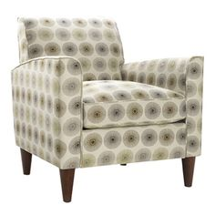 Add a pop of pattern to your living room or den with this lovely arm chair, showcasing a floral motif and tapered legs.    Product: