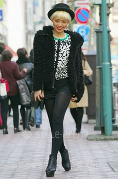 Tokyo street fashion:  I love her attitude.  Prime example of someone wearing the clothes...and not the other way around.
