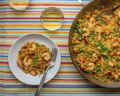 Shrimp scampi, shrimp in Italian garlicky butter sauce, joins the Spanish rice dish paella. Two classic dishes join to become one impressive dinner.