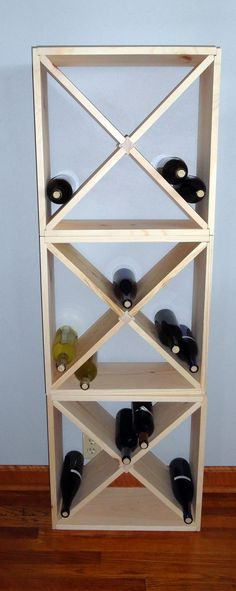 12 Bottle Wine Rack Cube Counter top Model Liquor Storage Solid Wood Modular Stackable  15 X 15 X 9. $29.99, via Etsy.