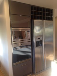 Microwave & oven tower with wine rack- must have