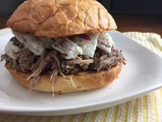 Serve up moist pulled pork with creamy coleslaw at your Super Bowl or Oscars party. The slow-cooker recipe lets you do other things while the meat cooks.