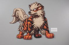 Perler and Artkal fuse bead Pokemon Arcanine by Manic Made Geekery