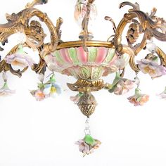 French vintage chandelier in bronze and porcelain, from Paris. This is a beautiful and very decorative piece in excellent original condition, dating to the middle of the 20th Century. It'sKeep reading…
