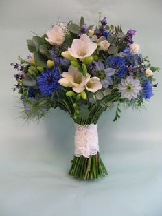 This dainty collection in cream and blues includes cornflowers, freesia, lavender and love in the mist. The bouquet has been tied with antique lace too.