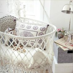 Crocheted hanging cradle for the nursery