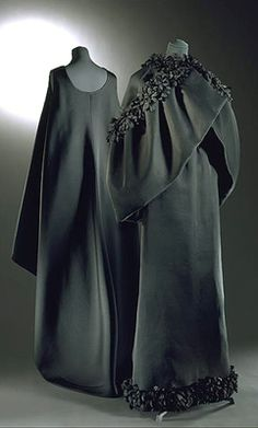 Evening gown and cape of black gazar  Designed by Balenciaga, Paris, 1960s      This gown shows Balenciaga's talent for cutting clothes in dramatic, sculpted shapes. These minimalist garments resemble the religious vestments of the Spanish Catholic Church.   From 1956, Balenciaga refused to show his clothes publicly at the same time as the other Parisian couturiers. This was because his designs were inevitably copied before he had finished making them up for his private clients.