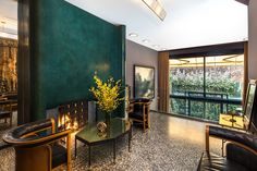 The gallery of this West Village townhouse includes Josef Hoffmann chairs from David Duncan Antiques, artwork from Regan & Smith and custom lighting by Fernando Santangelo. Photo by Evan Joseph
