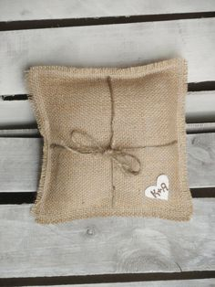"""8"""" x 8"""" Natural Burlap Ring Bearer Pillow w/ Jute Twine and Wool Felt Heart-Personalize w/ Initials- Rustic/Country/Shabby Chic/Folk/Wedding. $8.50, via Etsy."""
