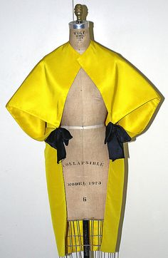 1965 - Evening wrap Design House: House of Balenciaga  (French, founded 1937) Designer: Cristobal Balenciaga (Spanish, Guetaria, San Sebastian 1895–1972 Javea) Date: ca. 1965 Culture: French Medium: silk Dimensions: Length at CB: 42 in. (106.7 cm) Credit Line: Gift of Countess Edward Bismarck, 1981 Accession Number: 1981.249.15