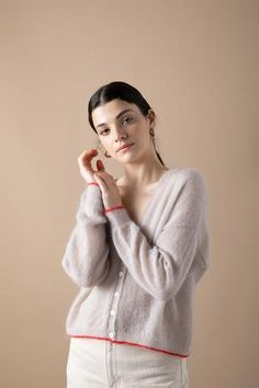 The Francie Mist Contrast Cardigan is a stunning sheer mohair cardigan with a dainty contrast...
