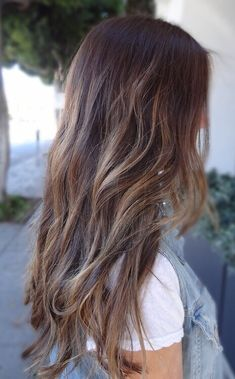 Brunette with blonde balayage highlight very natural