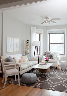This looks like our living room space with the bay windows and general layout. Thoughts on color scheme? I like the couch with the arm chair and light curtains.