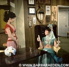 """I Dream of Jeannie: Behind the Scenes! On set photo taken while taping, """"Jeannie or the Tiger,"""" the first appearance of Jeannie's wicked twin sister, Jeannie.  Barbara's stand-in was Lainie Nelson. Here Lainie is seen wearing the pink costume, and a brunette wig.  Each scene featuring both sisters was shot twice, with Barbara playing both roles. Then in post-production the editors would splice the film together, featuring only Barbara as both Jeannie and her wicked twin. -Team Eden"""