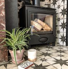 Wonderful Pic Fireplace Hearth decorations Suggestions Great Photos log burner Fireplace Tile Popular Enough time for those exposed bricks framing your fi Fireplace Hearth Tiles, Wood Burner Fireplace, Fireplace Inserts, Fireplace Surrounds, Fireplace Design, Wood Stove Surround, Log Burner Living Room, Freestanding Fireplace, Bedroom Fireplace