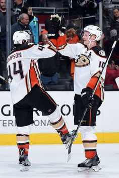 corey perry 10 and nate thompson 44 of the anaheim ducks celebrate their win